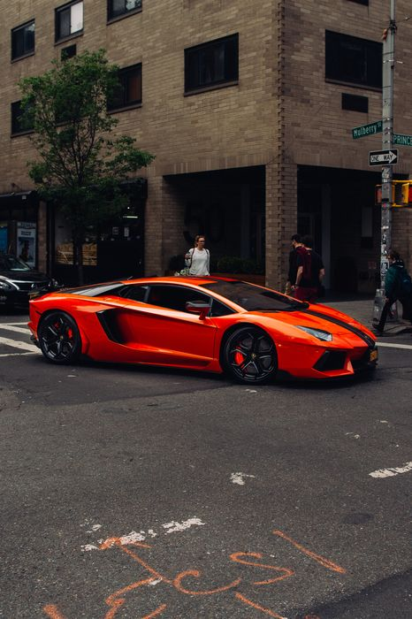 car lamborghini aventador red sportscar street town people