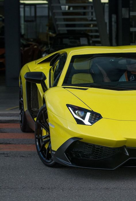 car lamborghini aventador yellow sportscar garage street