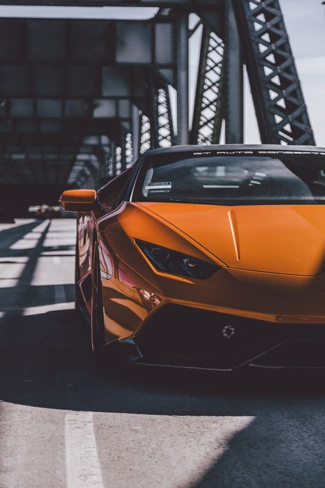 orange lamborghini huracan bridge sporscar luxury