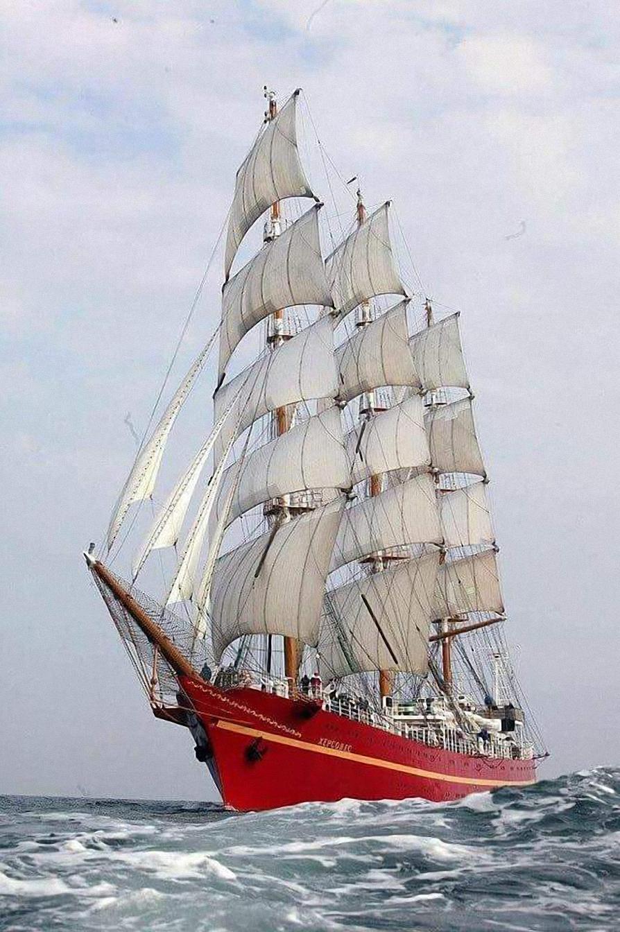 red sailboat ocean water