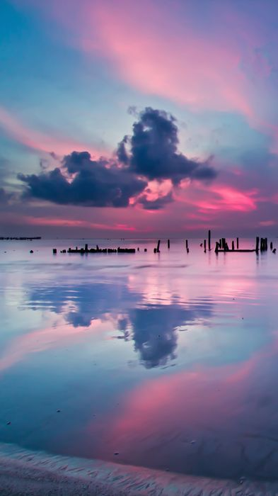 pink reflection clouds beach sea water coast sky landscape travel ocean shore sunset