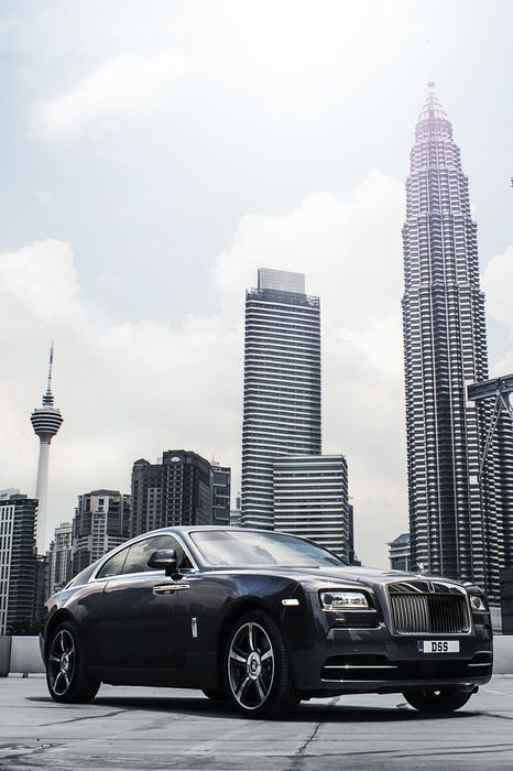 rolls royce wraith sportscar downtown cityscape skyline tower