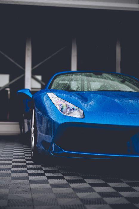 sportscar blue ferrari italia drops rain garage
