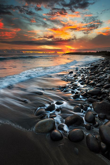 stones beach sea ocean water sky sunset landscape travel summer