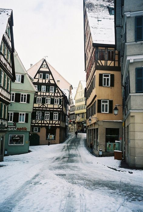 winter snow street building city houses road buildings house town old urban