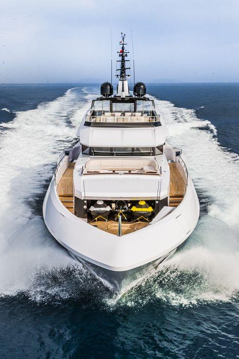 yacht boat vessel sky water sea ocean tugboat day summer ship