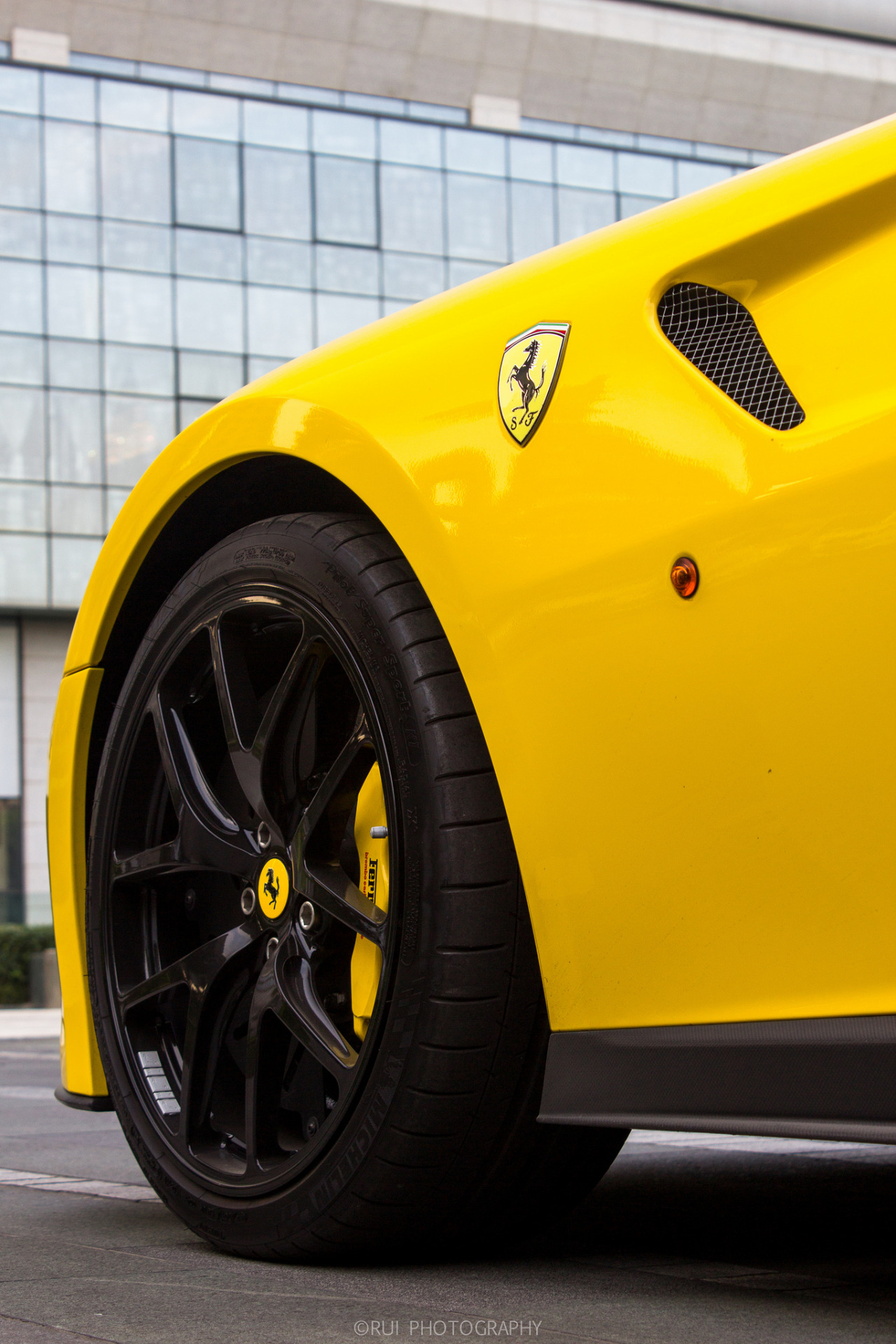yellow ferrari macro sportscar wheel horse