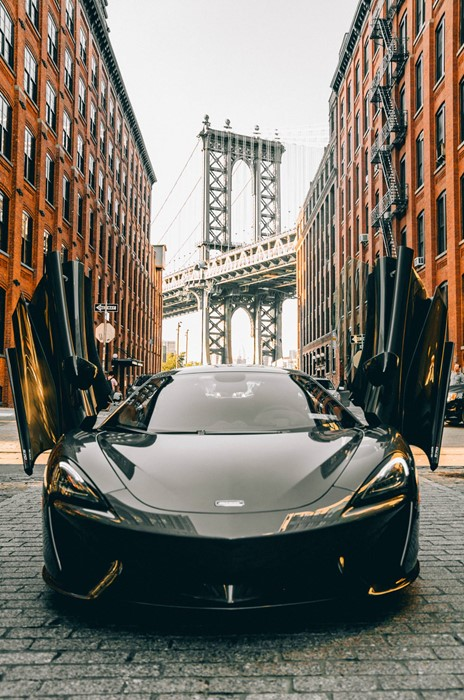 mclaren nyc black bridge city sportscar travel street urban building downtown