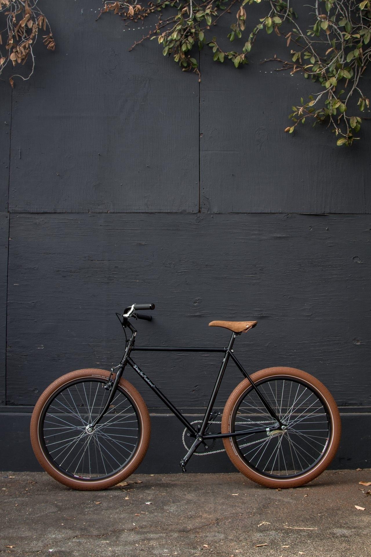 bike outdoors street wood rusty abandoned vehicle nature daylight urban