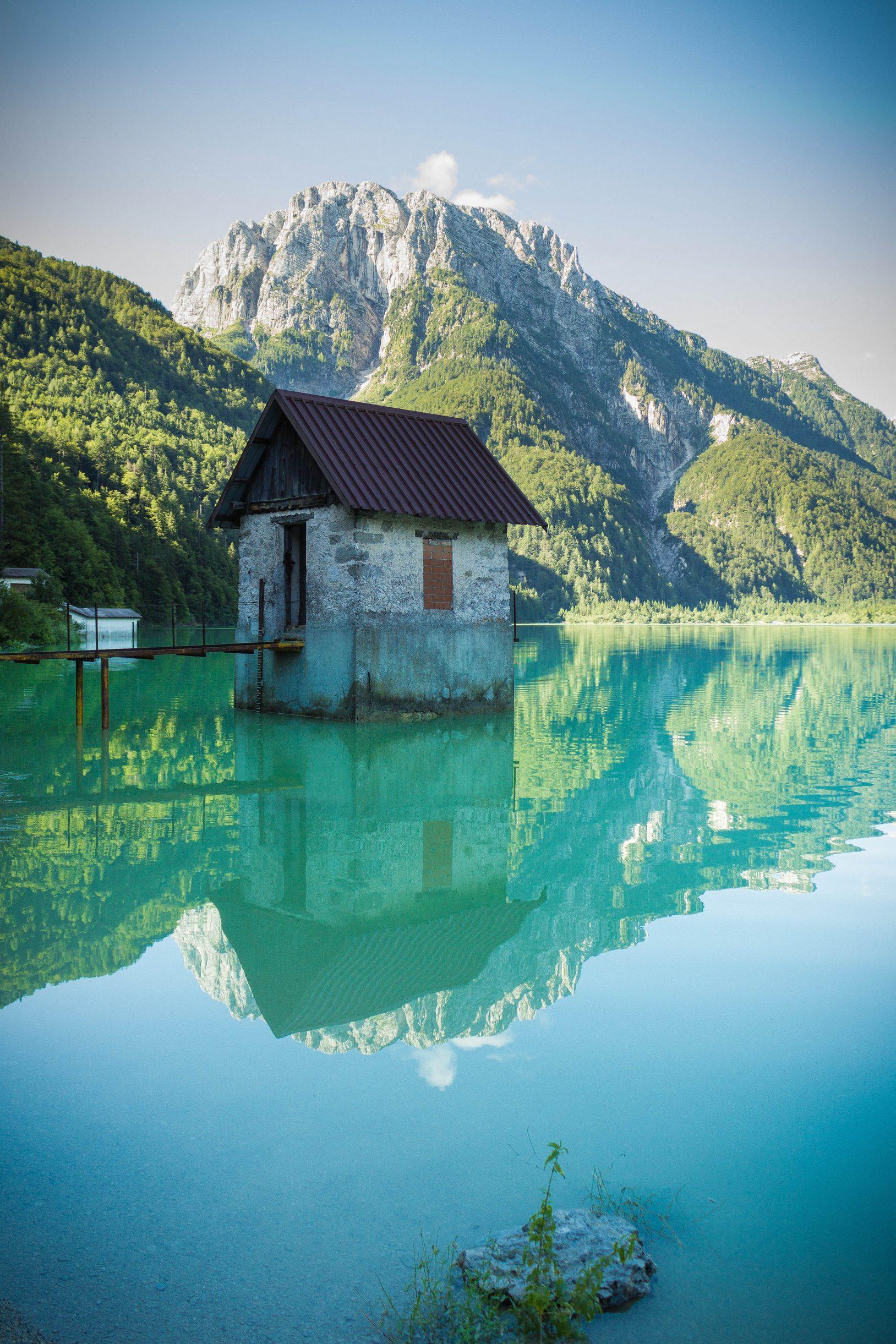 lake travel reflection summer sky mountain wood landscape house