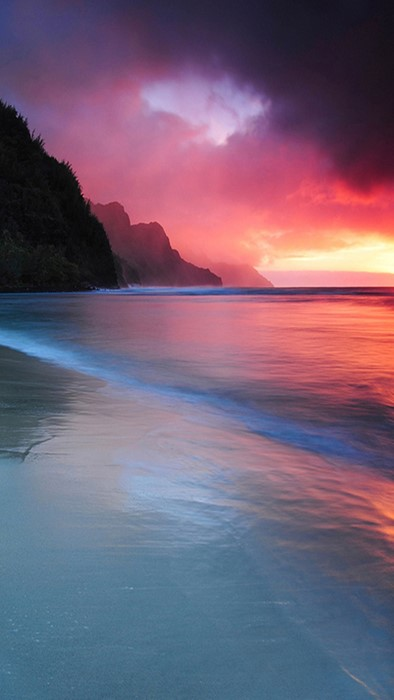 sunset water dawn evening dusk beach ocean seashore sun travel nature
