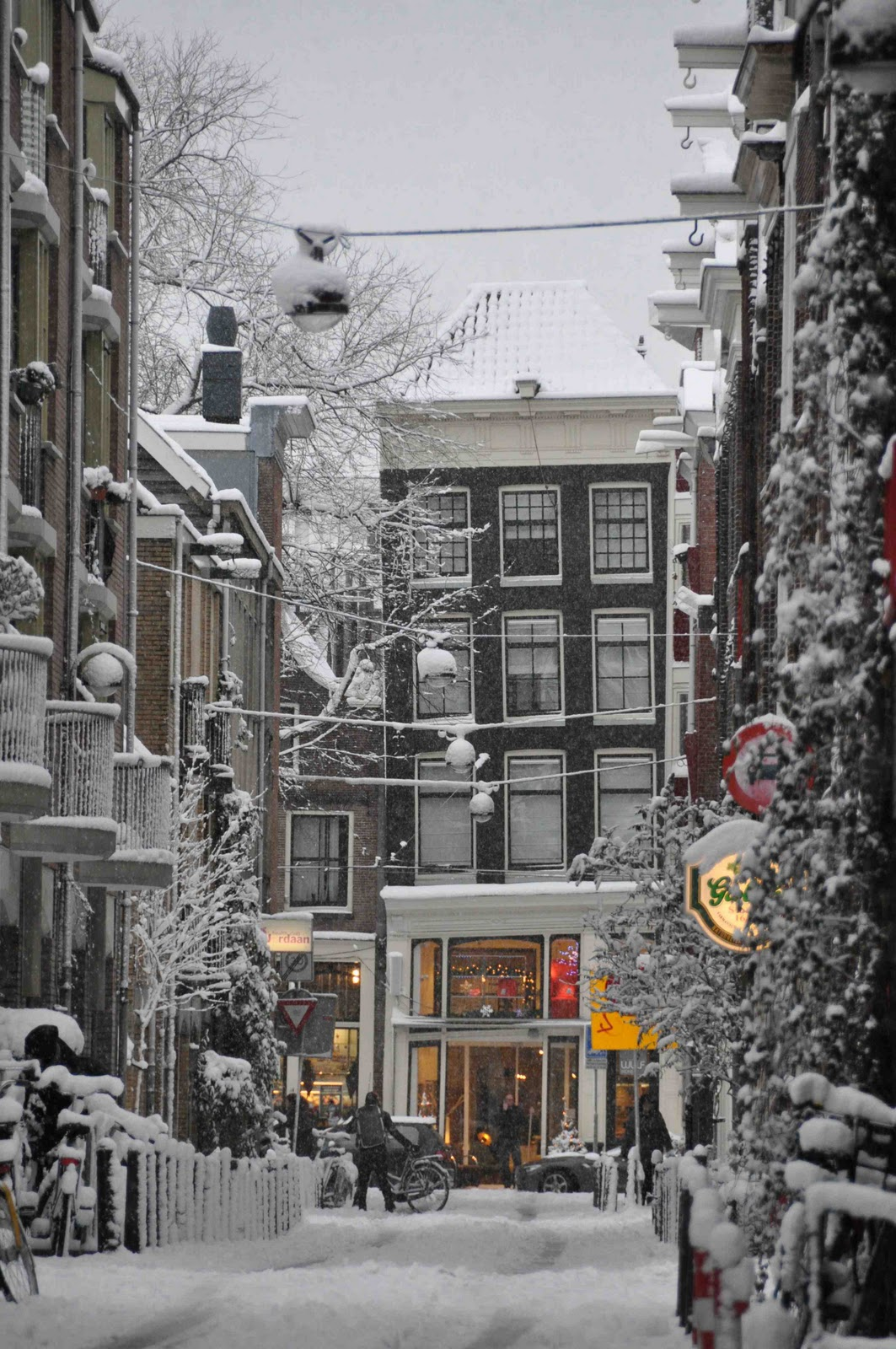 winter snow street city urban town travel road outdoors house architecture