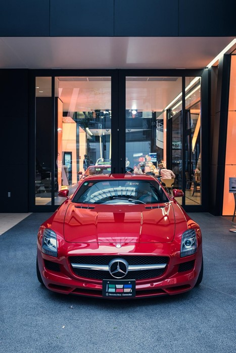 mercedes sportscar red exhibition pavement wheel luxury street fast drive