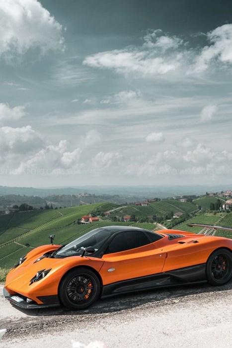 pagani zonda orange vehicle sportscar race hurry fast drive action landscape sky road