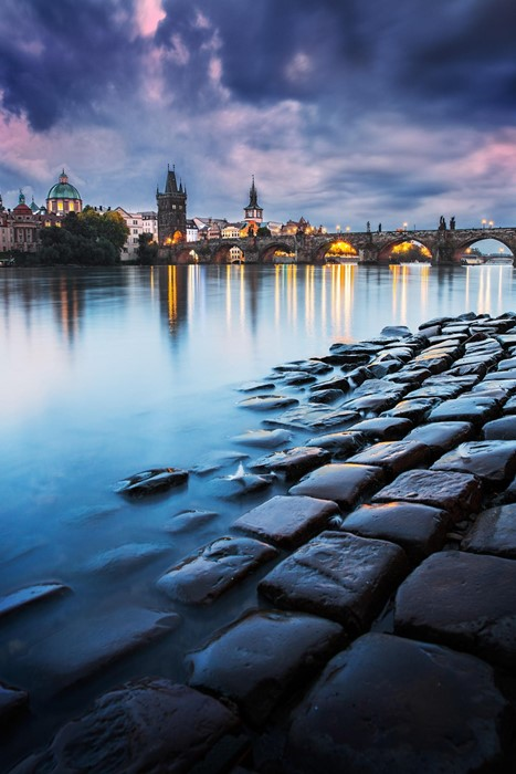 prague czech bridge water reflection dusk architecture city evening river light stones