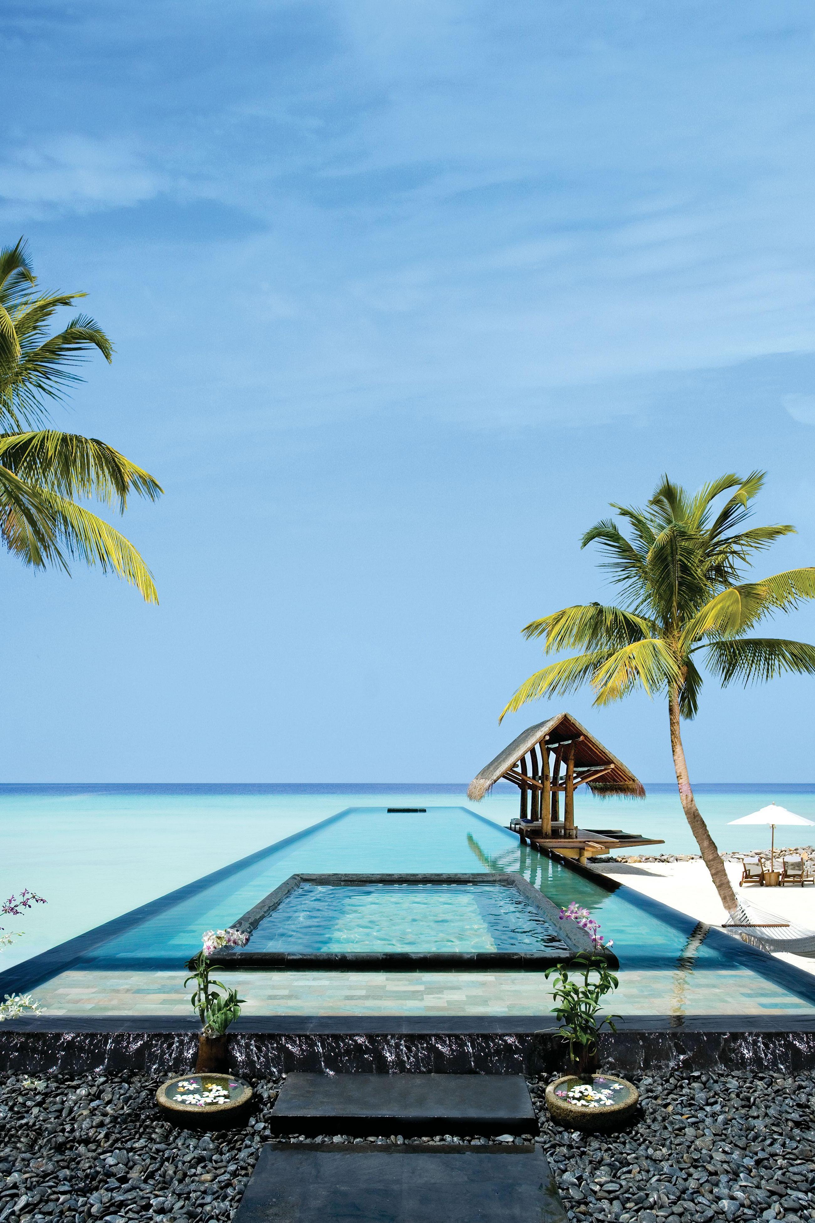 tropical palm beach exotic sand sun coconut island vacationl summer idyllic paradise hotel