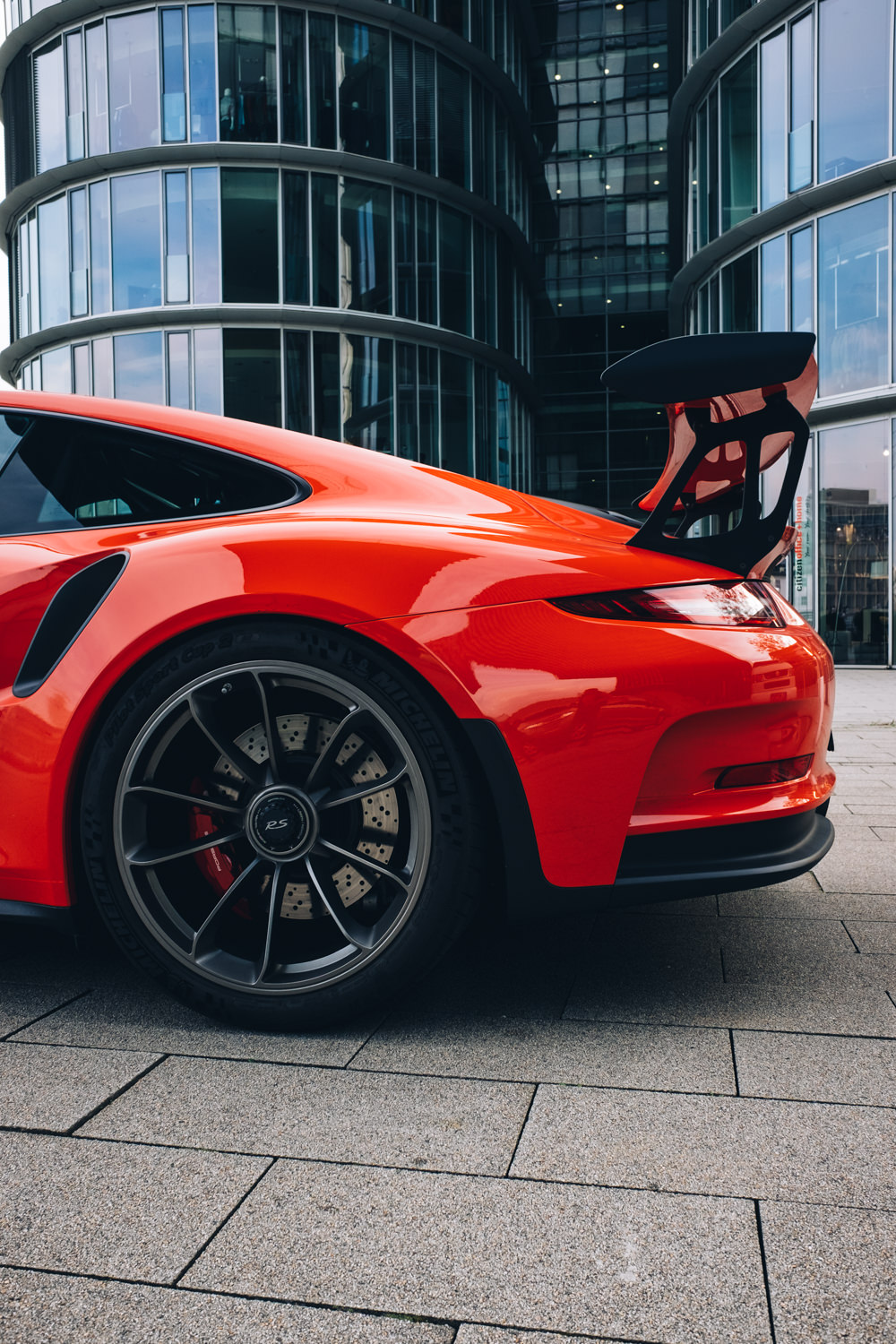 porsche red sportscar street city urban architecture vehicle road exhibition business