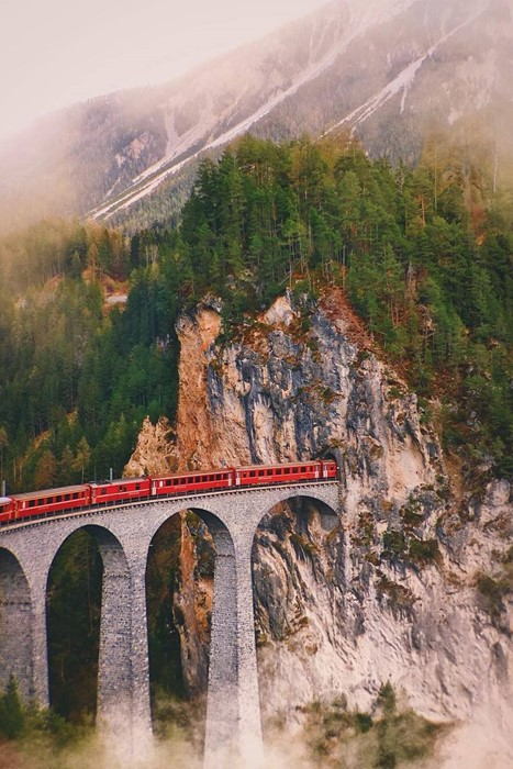 train mountain bridge travel landscape tree nature fog architecture road sky